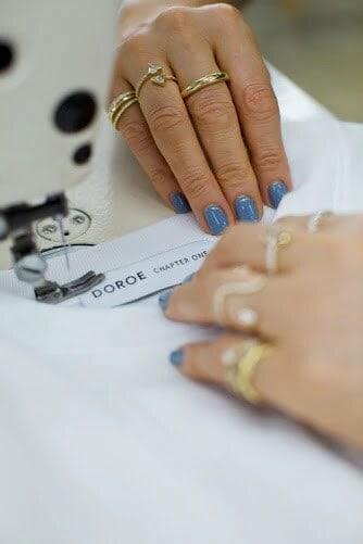 Hand sewing fashion label collar